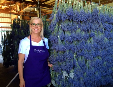 Karen in the barn where they dry the lavender
